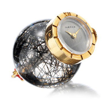 A Rutilated Quartz and Gold 'Coronation' Clock, by Cartier, circa 1953