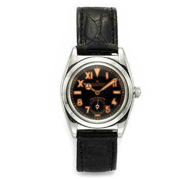 Rolex: A Black Dial Bubble Back Steel Wristwatch, Circa 1940