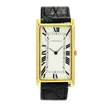 An 18k Gold Elongated Tank Wristwatch, by Cartier, circa 1950
