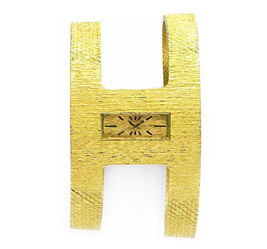 An 18k Gold Textured Wristwatch, By Tiffany & Co., Circa 1960