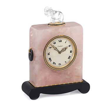 An Art Deco Rock Crystal, Quartz and Onyx Elephant Clock, by Cartier, circa 1920