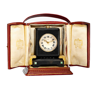An Art Deco Leather and Gold Minute Repeater Clock, by Cartier