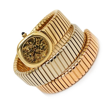 A Tri-colored Gold Tubogas Skeleton Dial Wristwatch, By Bulgari