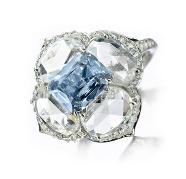 A Diamond Ring centering upon a Fancy Intense Blue Diamond of 1.15 carats, by Bhagat