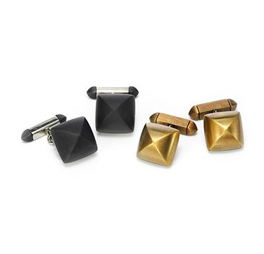 A Pair of Iron and Bronze Cufflinks, by Hemmerle