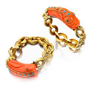 A Pair of Carved Coral, Diamond and Gold Figural Bracelets, by Van Cleef & Arpels, circa 1970