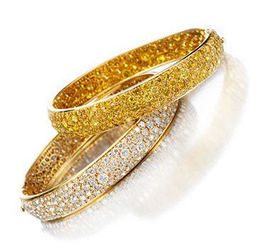 A Pair Of Diamond And Colored Diamond Bangles, By Van Cleef & Arpels
