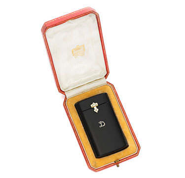 An Art Deco Onyx and Diamond Cigarette Case, by Cartier