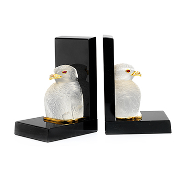 Commissioned by Prince Jefri of Brunei, each bookend is designed a rock crystal Peregrine falcon, mounted in 18k gold, perched on a black marble base, set with rubies and diamonds. Unmarked, made to order by Asprey. 8.5/8 inches