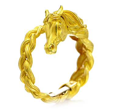 A Gold Horse Bracelet, by Hermes, circa 1960