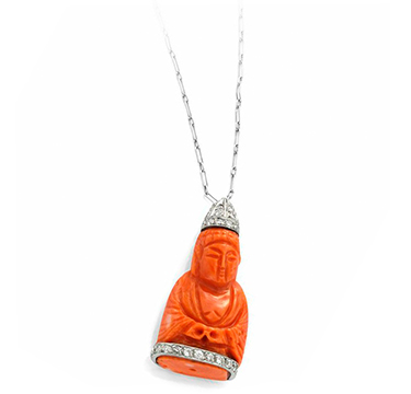 A Carved Coral Buddha And Diamond Pendant