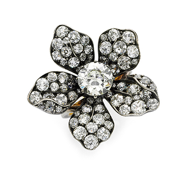 A Diamond And Silver-topped Gold Flower Ring