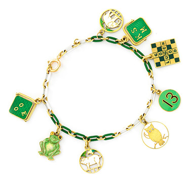 An Art Deco Enamel and Gold Charm Bracelet, circa 1930