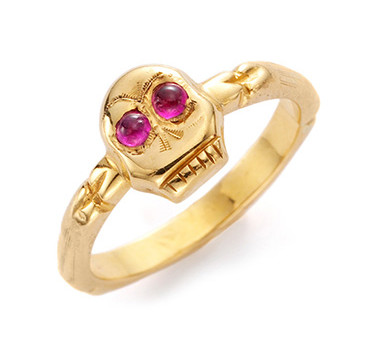 A Ruby And Gold Skull Ring