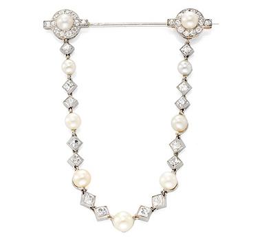 An Art Deco Natural Pearl And Diamond Pin