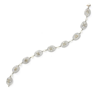 An Edwardian Moonstone And Diamond Bracelet, Circa 1900