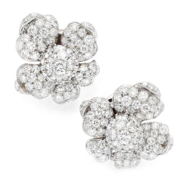 A Pair of Diamond and Platinum Flower Ear Clips, by Marianne Ostier