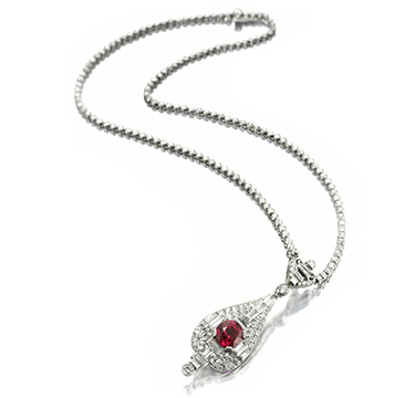 An Art Deco Ruby And Diamond Pendant, Centering Upon A Burmese Ruby, Weighing 3.25 Carats, Circa 1925
