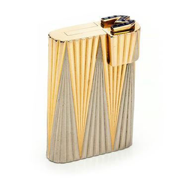 A Bi-colored Gold and Sapphire Lighter, by Cartier