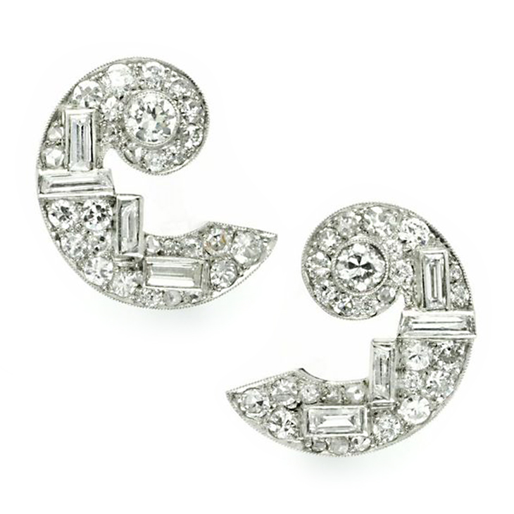 A Pair of Art Deco Diamond and Platinum Ear Clips, by Cartier, circa 1930
