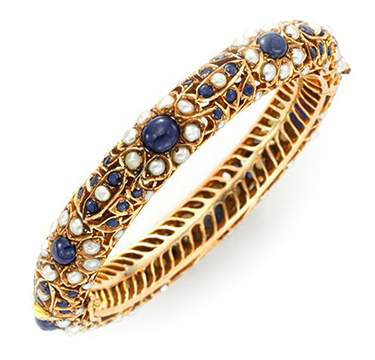 A Cabochon Sapphire, Seed Pearl and Gold Bangle Bracelet, by Van Cleef & Arpels, circa 1960