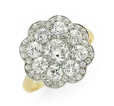 An Edwardian Diamond, Platinum And Gold Ring, Circa 1910