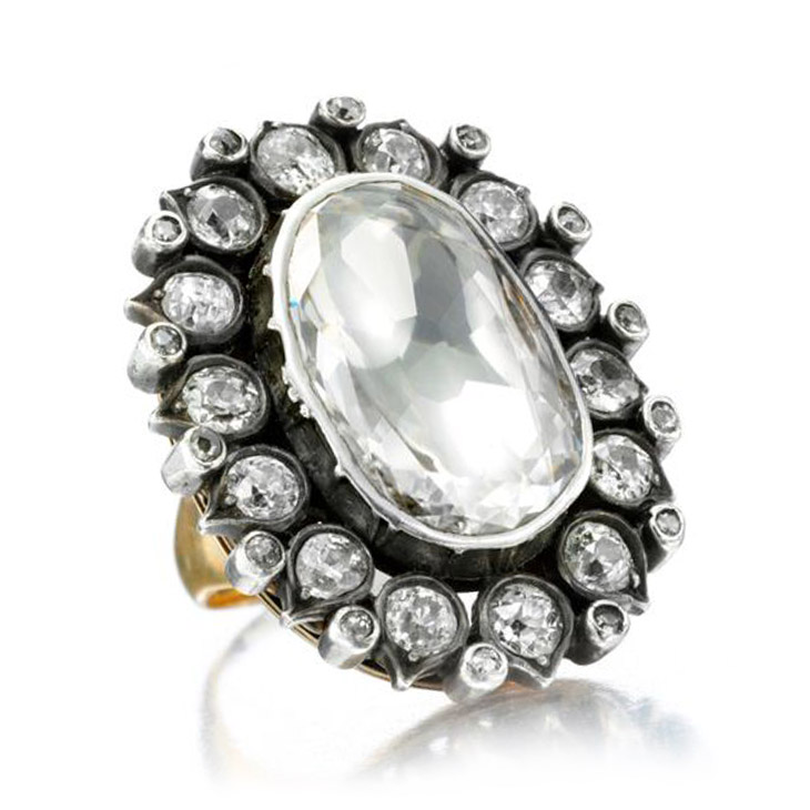 A Diamond Ring set with a central flat old mine-cut cushion-cut diamond