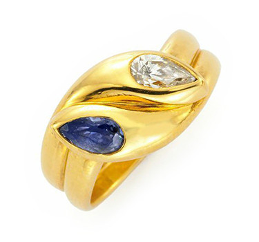 A Sapphire And Diamond Crossover Ring, By Bulgari, Circa 1980
