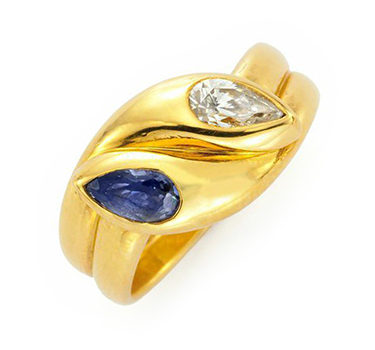 A Sapphire And Diamond Crossover Ring, By Bulgari, Circa 1980