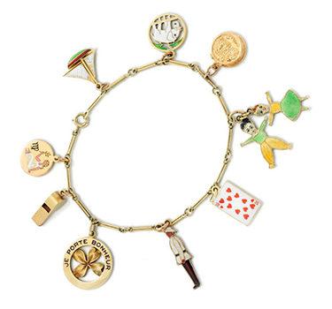 A Gold And Enamel Charm Bracelet, Circa 1930