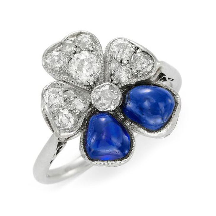 A Cabochon Sapphire and Diamond Flower Ring, circa 1935