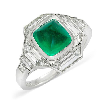 An Art Deco Colombian Cabochon Emerald and Diamond Ring