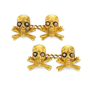 A Pair Of Gold And Diamond Skull And Cross Bone Cufflinks