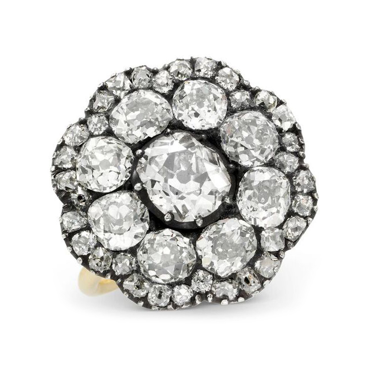 An Old European-cut Diamond Cluster Ring, set in silver and gold