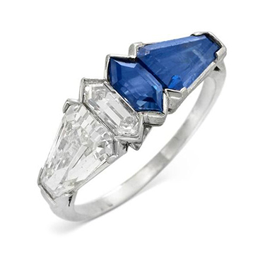 A Vari-cut Sapphire and Diamond Band Ring