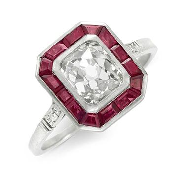 An Art Deco French-cut Diamond Ring, set within a border of calibre-cut Rubies, circa 1920