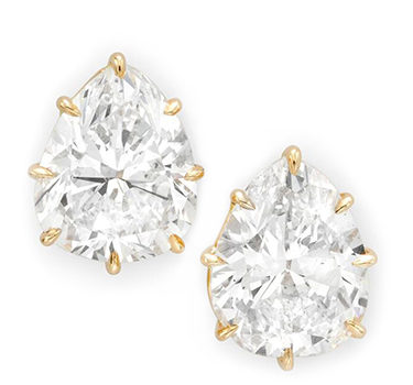 A Pair Of Pear-shaped Diamond Stud Earrings