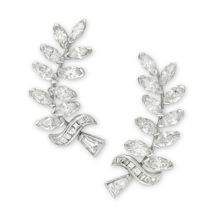 A Pair of Marquise, Baguette and Square-cut Diamond Ear Clips, of foliate design, circa 1945