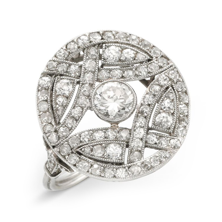 An Edwardian Diamond and Platinum Circular Plaque Ring, circa 1910