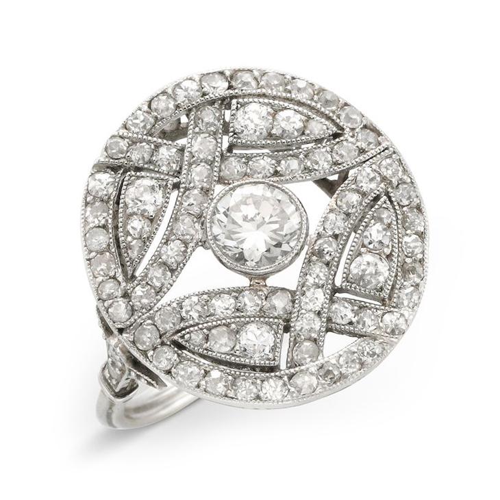 An Edwardian Diamond and Platinum Circular Plaque Ring, circa 1910