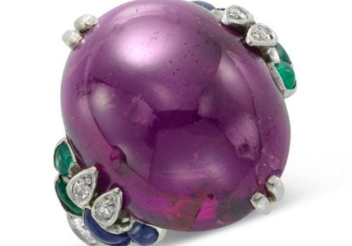 An Early 20th Century Cabochon Purple Sapphire