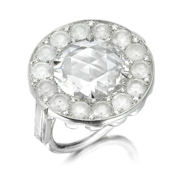 A Rose-cut Diamond, within a circular-cut diamond surround, by SABBA