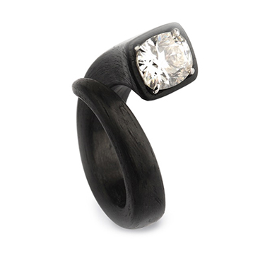 A Cushion-cut Diamond and Carbon Fiber 'Chiodo' Ring, by Fabio Salini