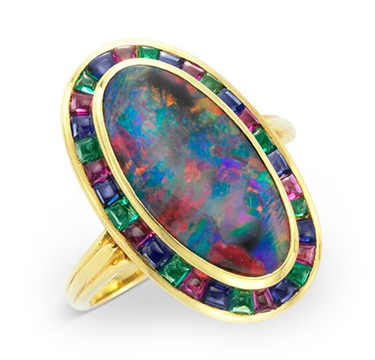 An Early 20th Century Black Opal, Ruby, Sapphire and Emerald Ring