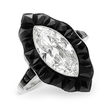 An Art Deco Marquise-cut Diamond and Calibre-cut Onyx Ring, circa 1925