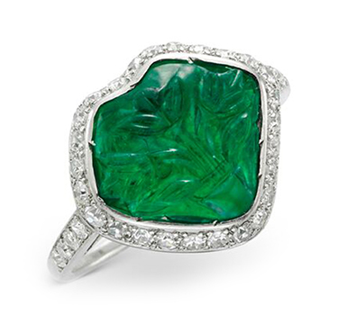 An Art Deco Carved Emerald, Diamond and Black Enamel Ring, circa 1925