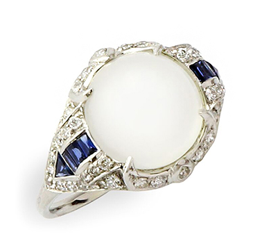An Art Deco Moonstone, Sapphire and Diamond Ring