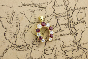 Ruby And Diamond Horseshoe Pendant