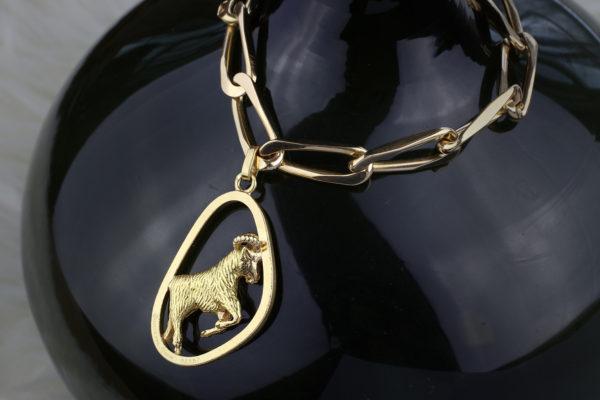 Gold Chain Bracelet Suspending A Boucheron Charm