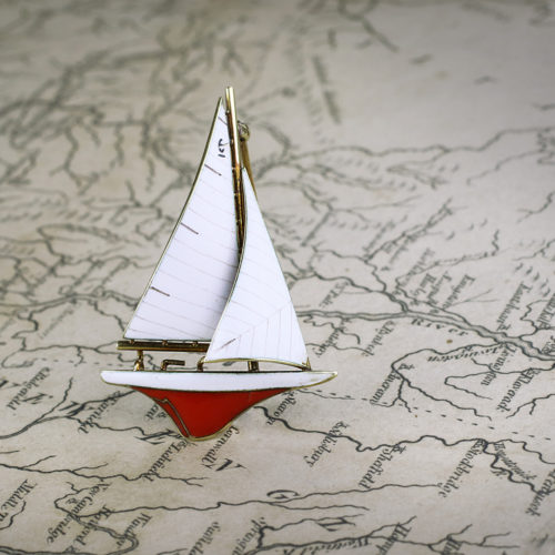 A Gold and Enamel Sailboat Pin